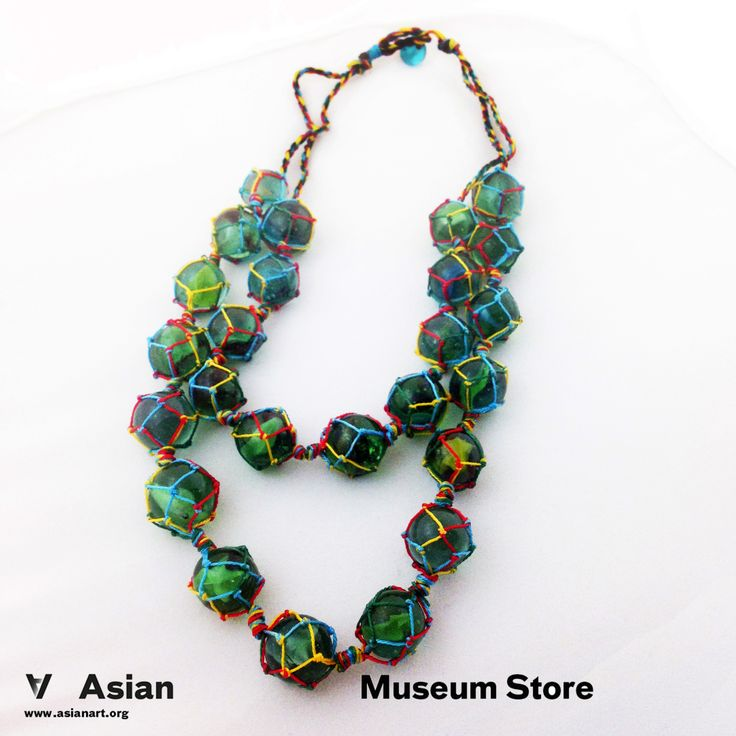 SOLD OUT Colorful nylon binds together strands of marbles to create these fun and fashionable necklaces. $25.00