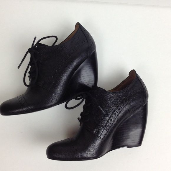 Black Oxford Wedges Nice lace up oxford wedges in black. 4-inch wedge. Worn once. Perfect condition. ❌NO TRADES❌ Nine West Shoes Wedges