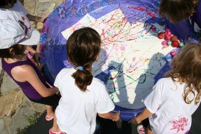 """Large scale """"Marble Painting"""" with a kiddie pool from * Pink and Green Mama Crafts: Mom Would Never Let Me Do This At Home! Outdoor Art Camp Lesson Plan E-book"""