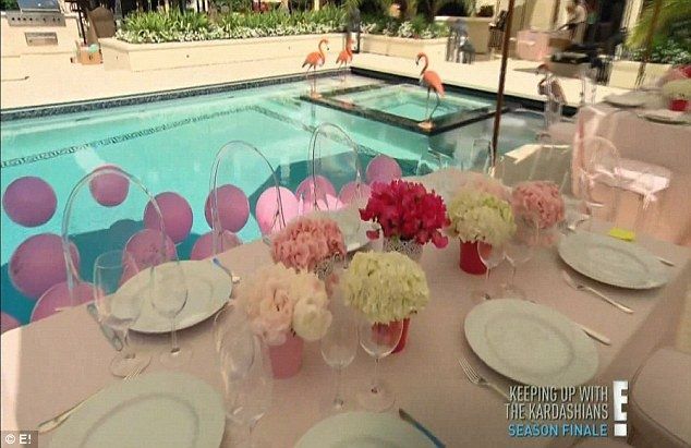 A beautiful baby shower, complete with flowers and pink balloons (in the pool)