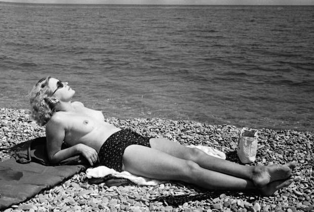 Lee Miller sunbathing in France in 1939 Roland Penrose Estate, England 2013. The Penrose Collection. All rights reserved