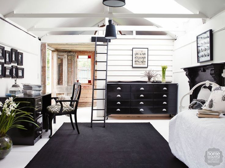 In this floristry studio, a dramatic black and white scheme is softened with the addition of a daybed, originally the owner's childhood bed.