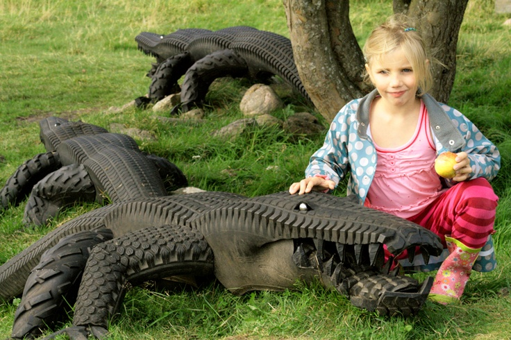 Alligators repurposed and old tires on pinterest for Used tire yard art