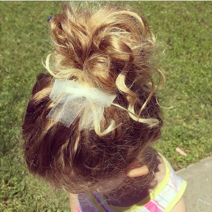 The cutest messy bun I ever did see! How adorable is our dainty Cream Tulle Bow is Sage's curly tresses?