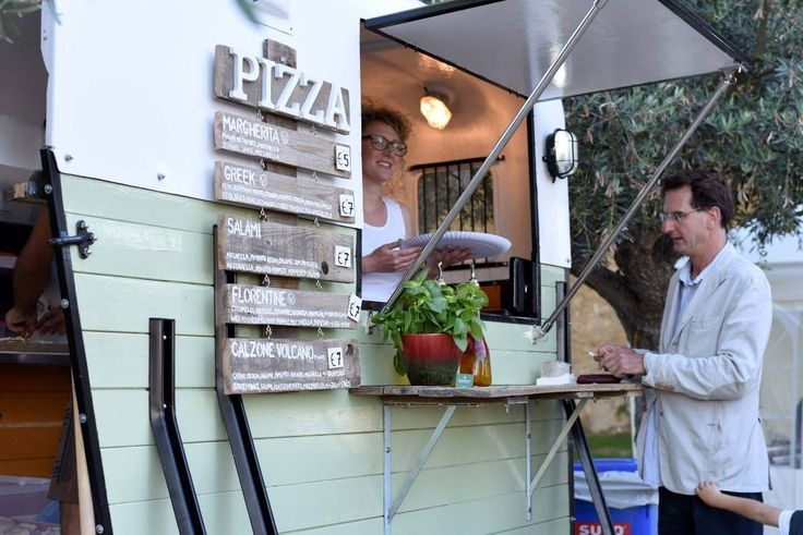 Vintage horse trailer converted into Pizza food truck.