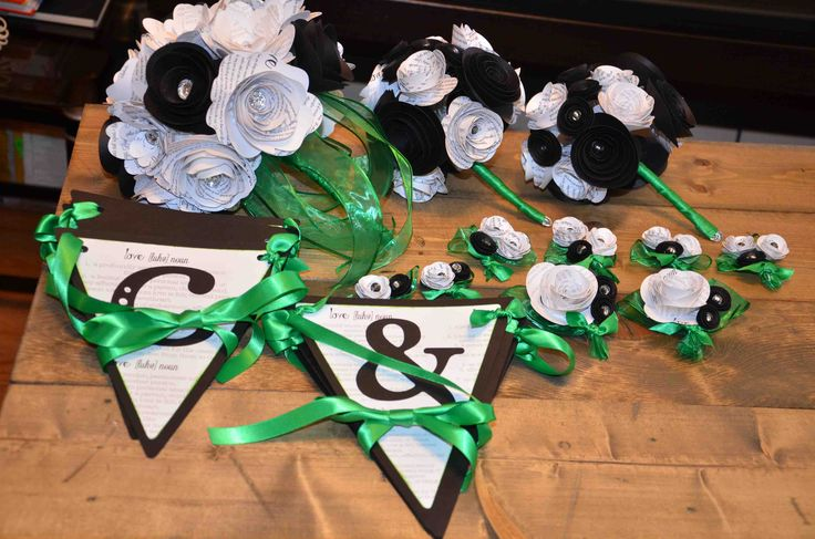 Paper bouquets, boutonnieres, banners all available at AJ's Craft Creations. https://www.facebook.com/ajs.craft.creations
