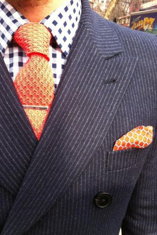 Men's accent pieces can be ties, scarves and pocket squares. Pocket squares are one of the most gentlemanly accessories. This vibrant orange tie and pocket squares should be brought to any trendy guys closet! and also for your maximum style points!