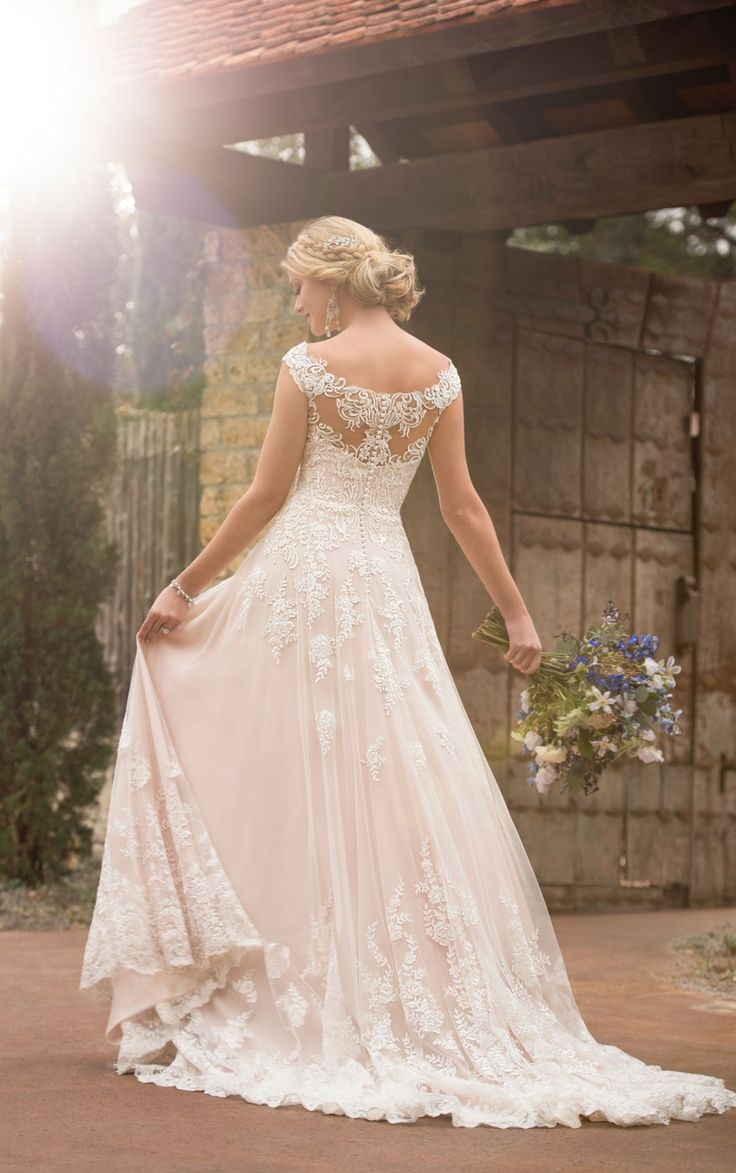 The casual boho wedding dress is simply a dream come true! Trend-worthy lace off-the-shoulder sleeves pair with a deep sweetheart neckline.