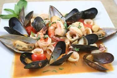 Zuppa di Pesce Marechiara Seafood in a light tomato based sauce.  This recipe originated in the Gulf of Naples area.