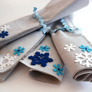 Felt snowflakes and rhinestones dress up fabric placemats.