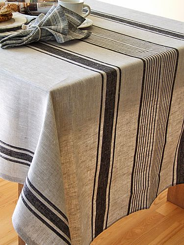 Black Linen Provence Tablecloth $80.00  Black stripes over natural grey colour shade backround. This wonderful mix of black and natural linen colours produces a French-style tablecloth, ideal for both formal and informal dining. Stripes are of various widths and will add character to your occasion, as well as bring many compliments to the table! 100% linen, machine washable. Custom made in Europe.