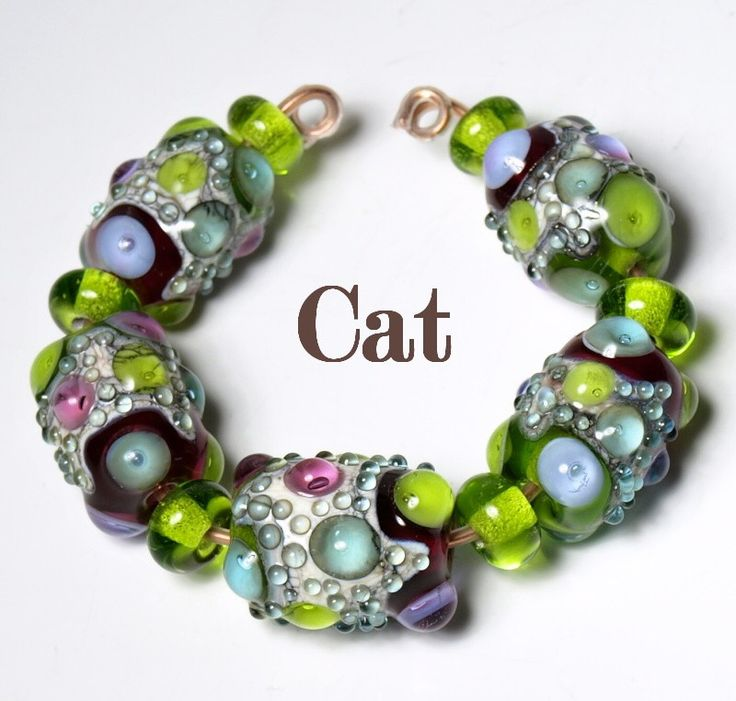 handmade lampwork bead set by catlampwork on etsy