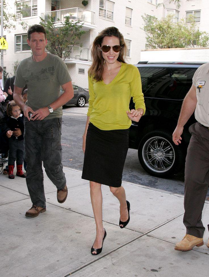 angelina jolie cute outfits - v-neck sweater, black pencil skirt, aviator sunglasses