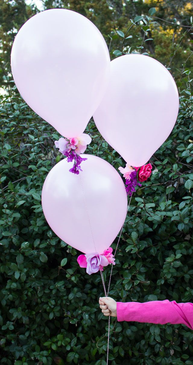 Combine artificial flowers with balloons for a gorgeous effect - perfect for weddings, showers, or a Valentine's Day bouquet! | http://www.designimprovised.com