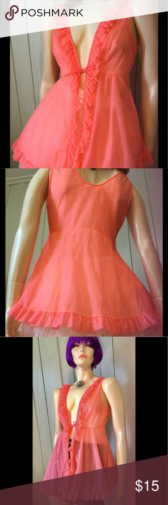 """Vintage MOD 60s Peach Sheer Chiffon Babydoll Top Ultra MOD vintage 60s sheer DBL nylon babydoll top in bright NEON peach. Ruffle chiffon trim front and hem. Ties at empire Bust. Would look cute layered over a summer top. Very Retro Glam.  Size: M  Bust:app 32-36"""" Up to 32"""" at empire seam under Bust. Length:App 17"""" from underarm to hem. Made In USA Material:100% Nylon Tricot (Fabric is light & sheer) Color:Peach Condition:VG. Some minor wear in a few areas in back showing slight tears in…"""