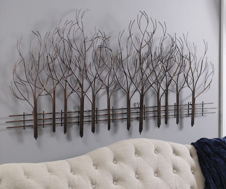 The Bronze Forest Metal Plaque is an enchanting piece of wall decor that combines nature with modern design. It's weathered bronze finish makes it look upscale, while also allowing it to blend with your other living room decor.