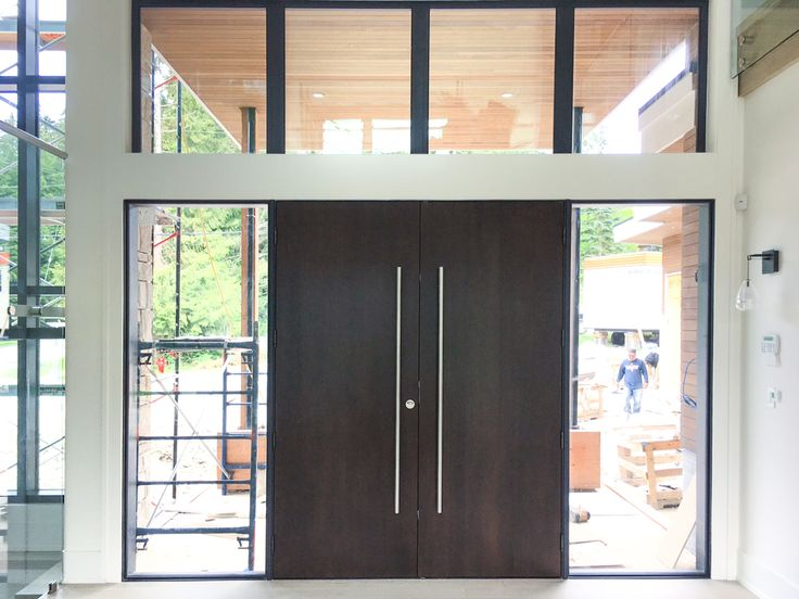 A gorgeous Westeck Entry System designed for #PostleConstruction in #Vancouver - With rift cut white oak slabs and a number of moving parts; from sight lines, custom slabs, installation and a massive opening! #customdoors #dreamhouse