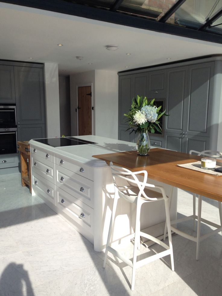 My Finished kitchen in gullwing grey and linen sculptured Matt from wren kitchens Linda barker range. Olympus white quartz worktop mixed with oak. Floor is blanco Carrara marble. Kartell Madter chairs in white.
