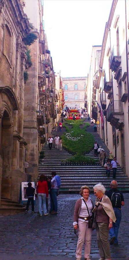 Scala di Santa Maria del Monte decorated for La Scala Infiorata (Flower Festival) in Caltagirone, Sicily http://www.odditycentral.com/events/scala-di-santa-maria-del-monte-probably-the-worlds-most-beautifully-decorated-staircase.html • photo: Adele Giglio on That's why Sicily