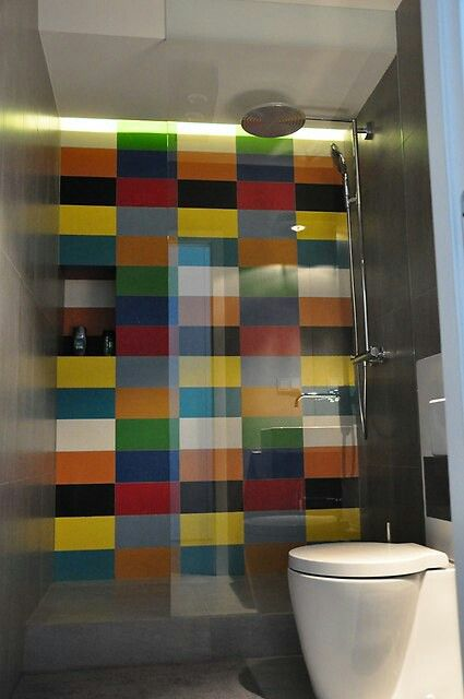 Coloured tiles and concrete shower