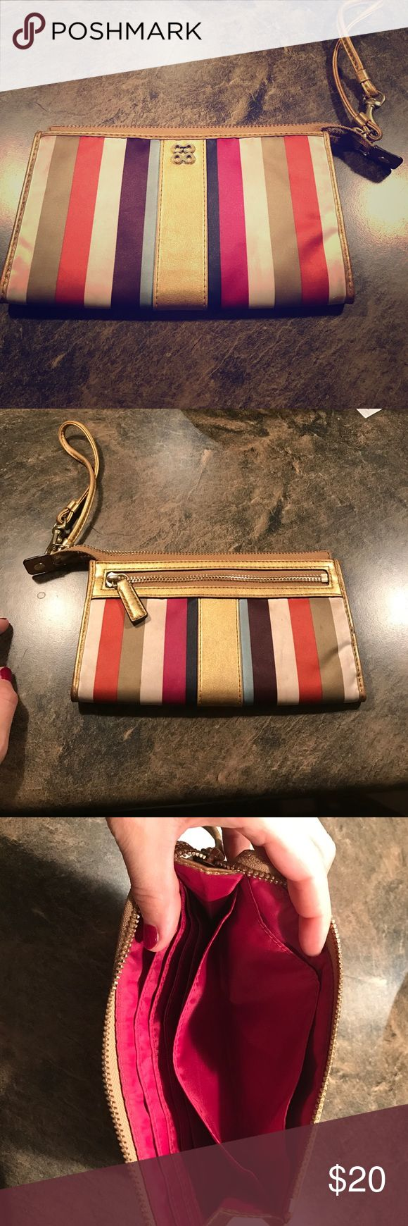 Coach multi color clutch Coach clutch. Used but in good conditions. A little dirty in a few corners where the ivory color is but overall in good shape Coach Bags Clutches & Wristlets