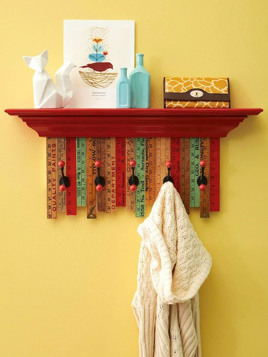 You'll find plenty of old yardsticks at flea markets, thrift stores, and antique stores. Scoop up a handful and make a creative coatrack and shelf. To make this one, we cut a piece of plywood the length of the shelf and about 10 inches wide, then cut and attached yardstick pieces to it using wood glue, staggering the bottom edges. After clamping and letting dry, we secured coat hooks to the board and screwed the shelf on top of the board. We were able to use the shelf hardware to hang, but…