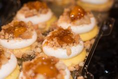 Vanilla buttermilk cupcakes stuffed with a spiked peach compote, frosted  with a boozy brown sugar cream cheese frosting, topped with homemade pie  crumbs,peach compote,whipped cream, and cinnamon.