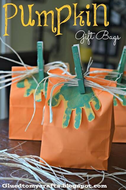 Super cute pumpkin gift bags!  Orange lunch bags Kids green hand print  Cloths pin painted green Grass hula skirt