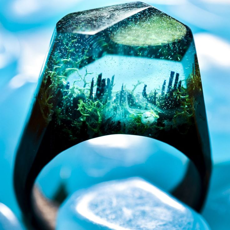 Ocean Oasis - Mystery inside your ring =This ring is made of teal resin and bits of seaweed. The base is wenge wood, a tropical timber which is both heavy and hard. Z