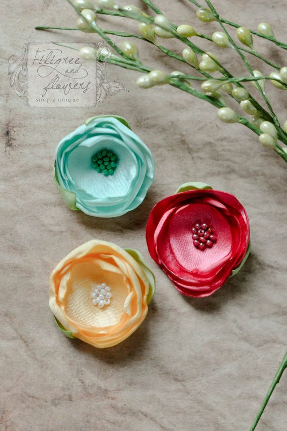 satin hair clips in Seaside  set of 3 mini hair by filigreeflower, $11.25  My girls have a set of these in different colors.  Very High quality.  These flower petals are hand made - not just a satin flower with a hairclip put on it!
