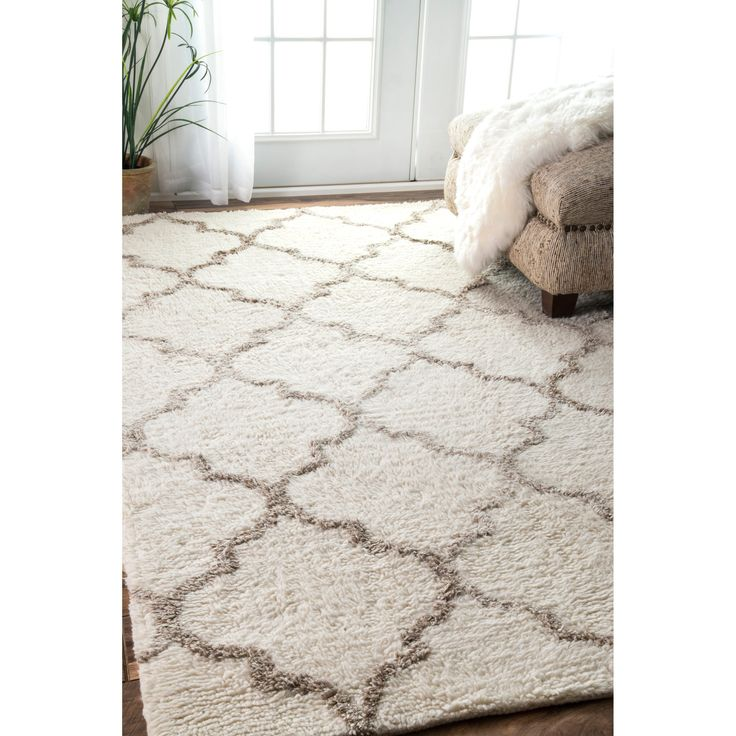Give your room a warm cozy feeling with this beautiful area rug. This handmade shag rug features a durable pile suitable for high traffic areas.