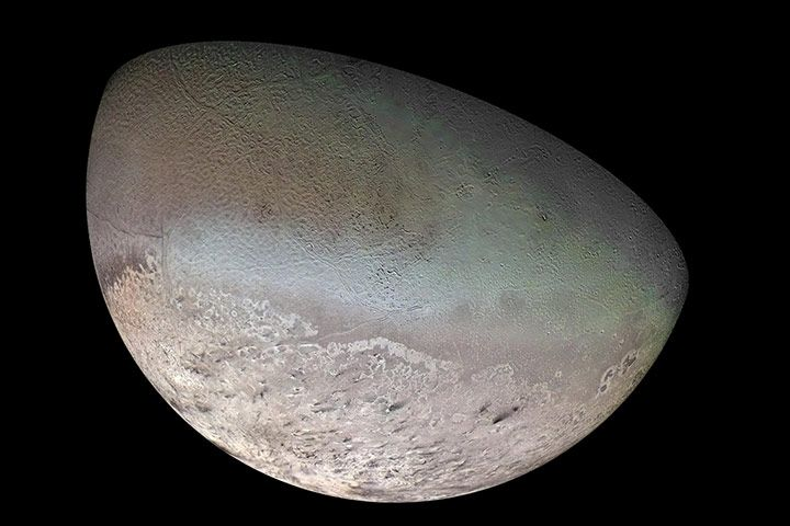 Credit: USGS/JPL/NASA The most distant moon yet to be seen in close-up is Triton, the largest moon of Neptune. It has a thin, nitrogen atmosphere and seasonal polar caps of nitrogen ice. Only the south polar cap is visible in this shot, because the northern one was in seasonal darkness. Beyond the polar cap is a richly textured surface formed largely by icy volcanism