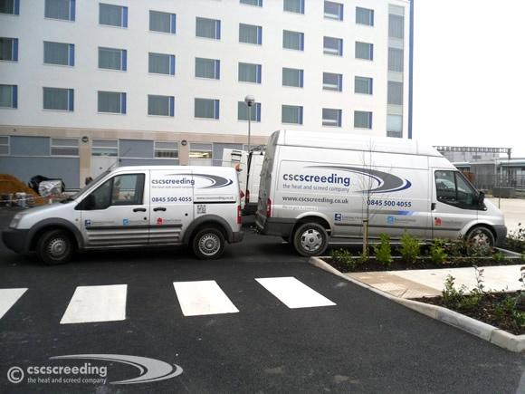 CSC vans at a hotel floor screeding project.