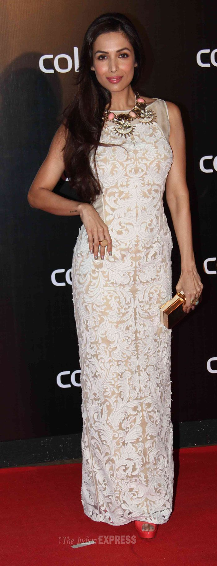 Malaika Arora Khan attended the party wearing a white Pankaj and Nidhi applique gown on the red carpet Colors International Advertising Associations (IAA) Awards. #Style #Bollywood #Fashion #Beauty