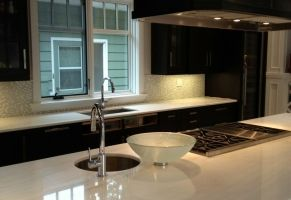 Residential Kitchen - Polished Marble Island and Counter Top  Scope of work: sand to remove existing damage, apply topical coating to protect marble from future etching and staining and polish coating to a high shine.