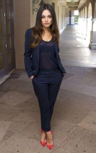 Mila Kunis in midnight blue suit, dark top and great red heels