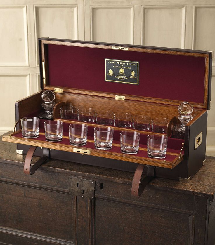 Large Oak And Leather Drinks Cabinet - open | The interior is decked out in Audley House red baize with a James Purdey & Sons case label, featuring compartments for two bottles of your favourite malt or brandy, and removable trays. | James Purdey & Sons