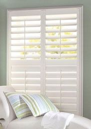 Simple, Chic White Faux Wood Shutters  Create A Timeless Look At The Window.