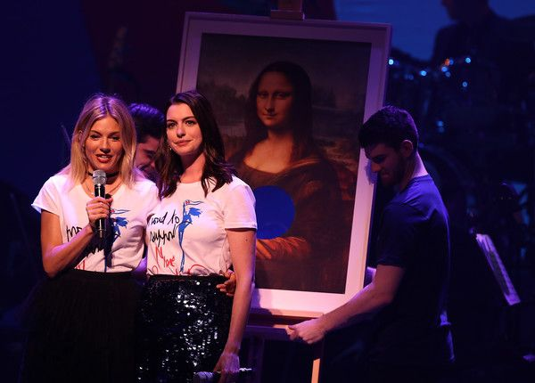 Anne Hathaway Photos Photos - Sienna Miller (L) and Anne Hathaway perform during the Hillary Victory Fund - Stronger Together concert at St. James Theatre on October 17, 2016 in New York City. Broadway stars and celebrities performed during a fundraising concert for the Hillary Clinton campaign. - Fundraiser Event Held for Hillary Clinton's Presidential Campaign in Manhattan