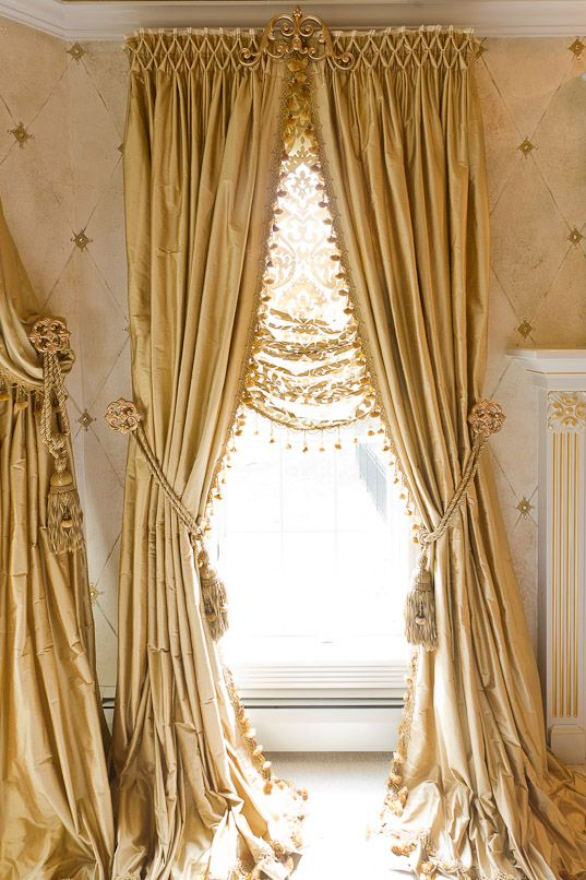 Beautifully smocked silk curtains with sheer Roman I like the bottom not the top cornice. Looks cheesy!