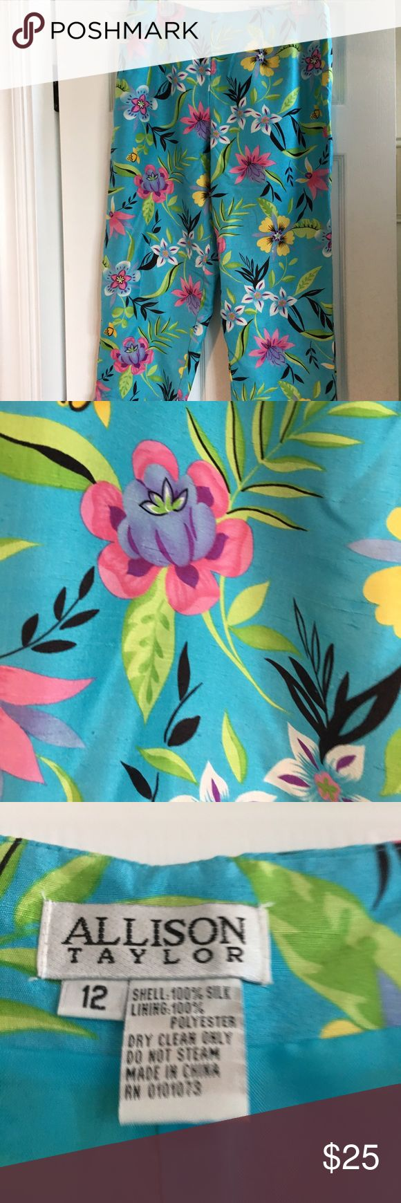 """Allison Taylor ankle Pant: SILK tropical turq 12 Allison Taylor ankle pant of 100% silk turquoise tropical print. LINED. In-seam to hem 24-1/2"""". Rose, yellow, & purple flowers w/slender black leaves. 1-1/2"""" slit outside ankle. Side zip & 2 darts front & back. Non-smoking home. SIZE 12 (Similar unlined @ Chico's NOW Reg. $89 on sale for $49) Allison Taylor Pants Ankle & Cropped"""