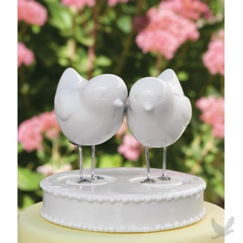 """$22 Love Bird Figurines and Base Wedding Cake Topper - These charming birds wedding cake toppers feature lightly-sculpted details and silver metal legs adhered to its own stepped ceramic base, ceramic beaded detail on the edges, as well as two holes for the birds to fit into. Set includes two ceramic bird figurines and base. *Note: These figurines are handmade, each piece is unique and may not appear exactly as shown in photo. Figurine Height: 3"""" Base: 5"""" x 1""""."""