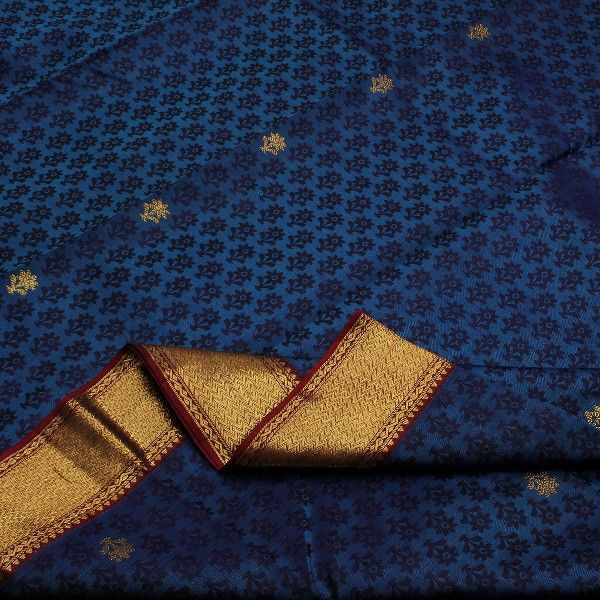Reflecting the beauty of a sapphire sky with dark clouds, this #silk sari in blue is smothered with navy blue floral motifs, with occasional ones highlighted in gold. A gold wave pattern dominates the border edged in a wine red. Geometric extravaganza in dazzling gold motifs on wine red silk adds drama to the pallu. Wine red blouse with running border completes this #Kanjivaram silk sari. For such beautiful blues, visit Sarangi. Code 390125928.