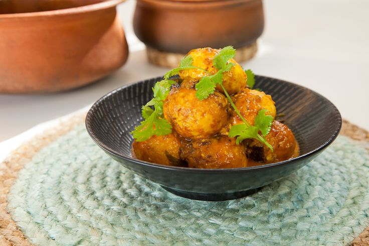 This is a curry that my vegetarian Grandmother used to love. It's full of goodness and really tasty. Deep frying peeled eggs gives it a tofu like exterior that absorbs the gravy.