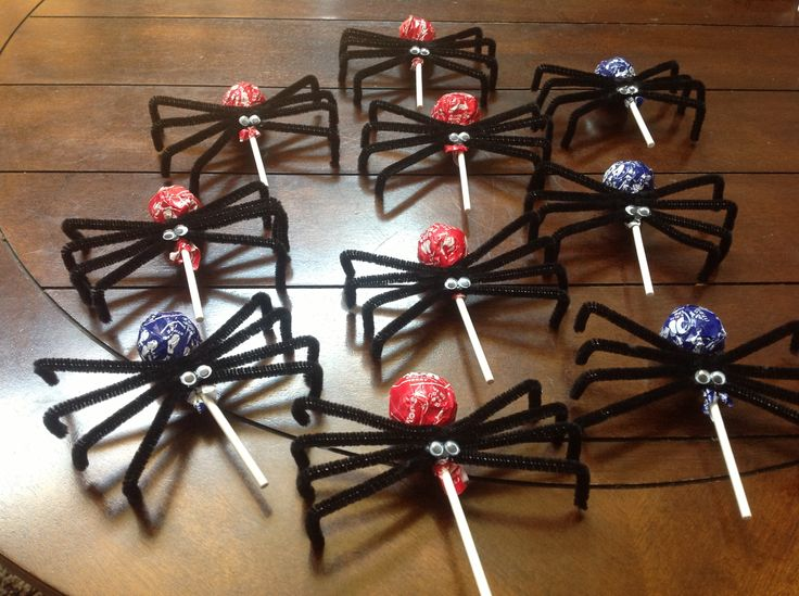 MADE THESE...Lollipop spiders...except I forgot to pu the eyes on before sticking them in the pinata...guess I'll just have to make them again!
