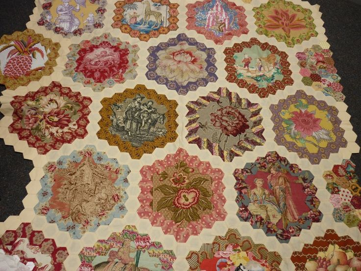 beautiful fabrics in hexagon frame, perhaps inspired by Levens Hall quilt