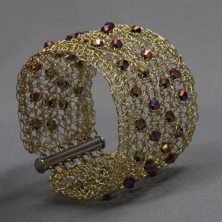 made of enameled coper and Czech crystals