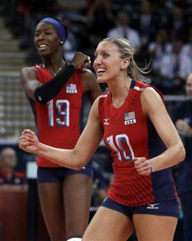United States' Destinee Hooker, left, and teammate Jordan Larson celebrate during a women's preliminary volleyball match against Brazil at the 2012 Summer Olympics, Monday, July 30, 2012, in London. (AP Photo/Jeff Roberson)
