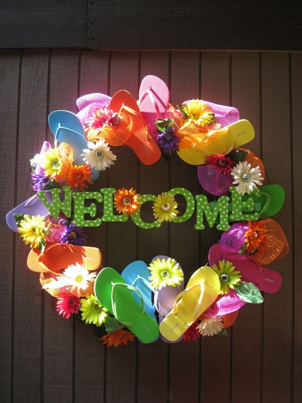 Cutest Flip Flop Wreath Ive seen! The wreath is a grapevine wreath from Hobby Lobby, wood letters from Hobby Lobby are painted, flowers came from Hobby Lobby, and one dollar flip flops from Old Navy catefreeman
