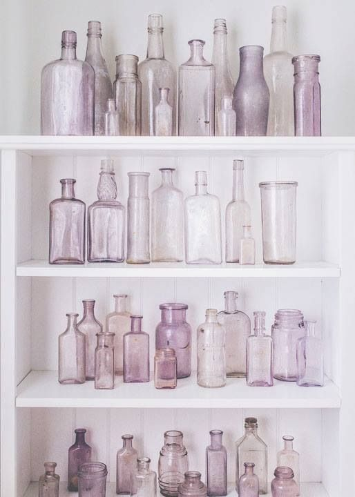 Set against a stark white background, the delicate pop of color from the many shades of purple bottles creates a delightfully different bit of wall art. #ExclusivePlum